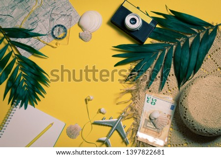 Camera, touristic maps, colorful pens, euro banknotes and coins on the white desk. Travel background. Journey planning. Tourist essentials. Space for text. Top view copyspace #1397822681