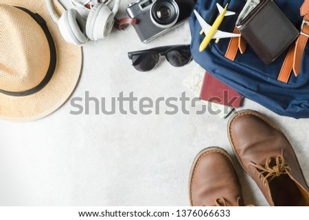 Camera, touristic maps, headphones, wallet and hat. Travel background. Journey planning. Tourist essentials.  With copy space .