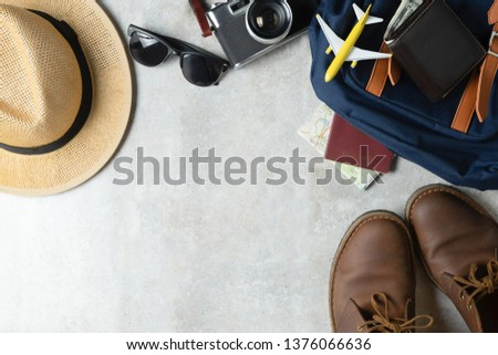 Camera, touristic maps, shoes, wallet and hat. Travel background. Journey planning. Tourist essentials.  With copy space . #1376066636