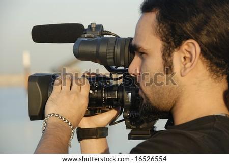 Cameraman Filming Outdoors