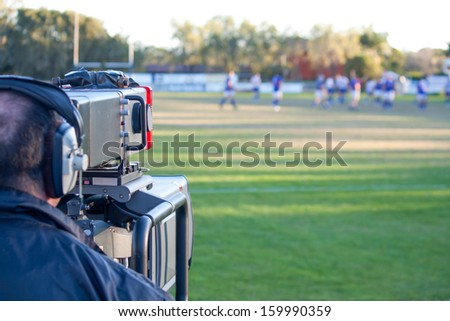 Cameraman filming rugby #159990359