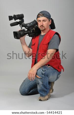 cameraman in red vest - stock photo