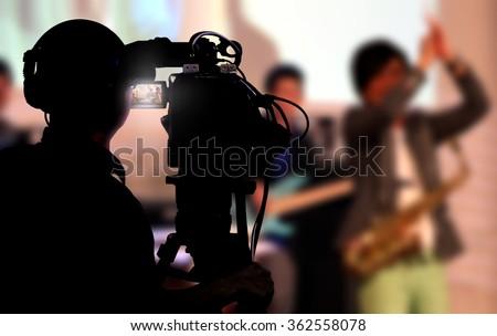 Cameraman shooting a live concert Сток-фото ©