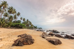 Cameroon, South Region, Ocean Department, Kribi, sandy beach and palm trees by the sea
