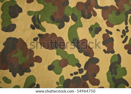 Camouflage Background On Beige Green And Black Used For