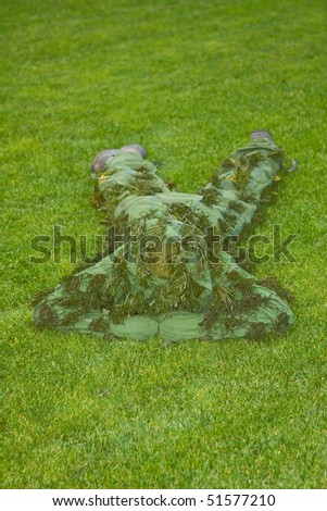 Camouflage man on the green background