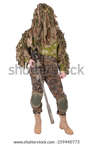 Camouflaged sniper in ghillie suit isolated