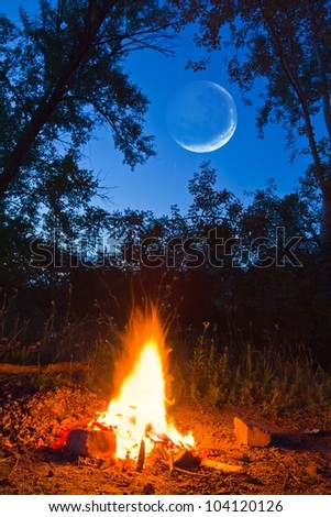 camp fite and a moon