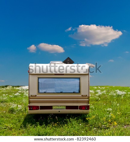 Camp mobile on a meadow with a blue sky background