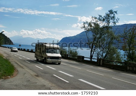 Camp-site bus at the edge of a lake