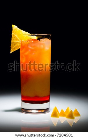 Campari orange cocktail with slice of orange isolated on the black background