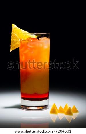 Campari orange cocktail with slice of orange isolated on the black background