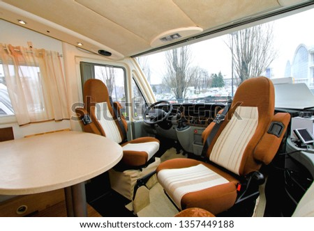 Camper Cabin Interior With Rotating Seats in Recreation Vehicle  #1357449188