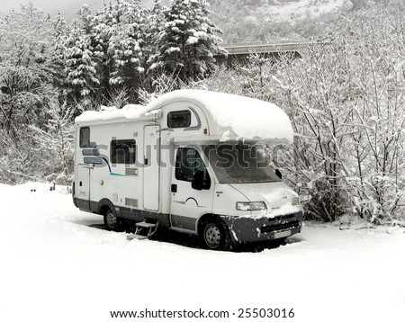 Camper covered in fresh snow