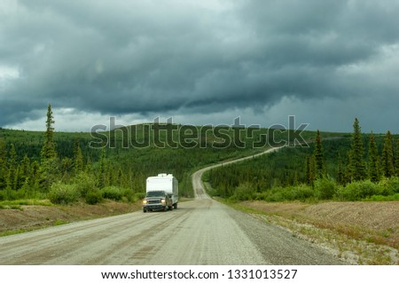 Camper on unpaved Top of the World highway in Alaska #1331013527