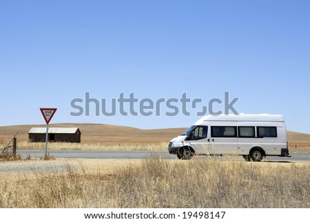 Camper van on its way in the desert in Australia