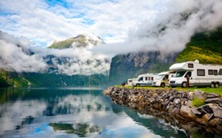 Camper van recreational vehicles (RV) parked at norwegian campsite on a fjord coast, Norway, Scandinavia