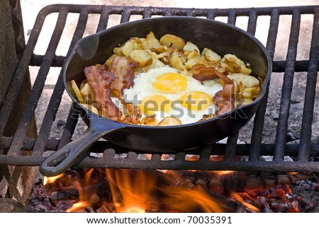 Campfire breakfast of eggs,bacon and potatoes