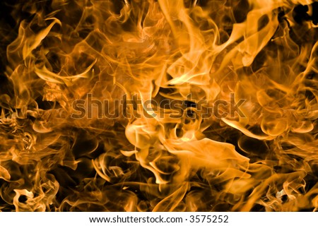 Campfire flames bright firey orange and yellow background