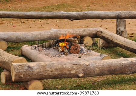 Campfire wood, surrounded by warmth in cold weather, lighting and cooking.