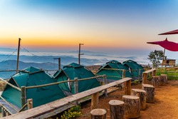 Camping and green tent on the hill with morning misty mountain at Ban Doi Sa-ngo Chiangsaen Chiangrai Thailand.