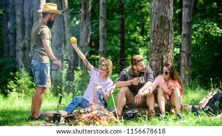 Camping and hiking. Company friends relaxing and having snack picnic nature background. Great weekend in nature. Halt for snack during hiking. Company hikers relaxing at picnic forest background.