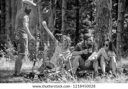 Camping and hiking. Company friends relaxing and having snack picnic nature background. Great weekend in nature. Company hikers relaxing at picnic forest background. Halt for snack during hiking.