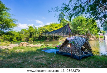 Camping and tent in nature park near the river #1340392370