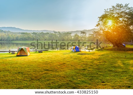 Camping and tent near lake in sunrise #433825150