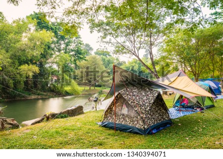 Camping and tent near the river #1340394071