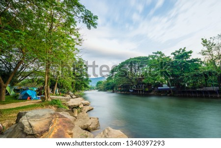 Camping and tent near the river #1340397293