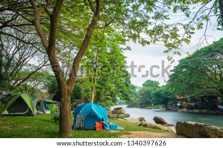 Camping and tent near the river #1340397626