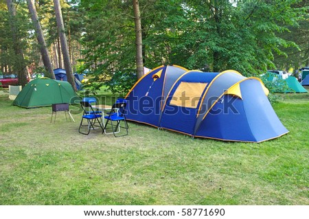 camping and tents on the grass in the summer