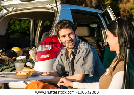 Camping car happy young couple enjoy picnic sunny countryside