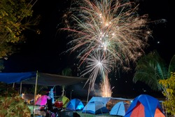Camping concept. The festival fireworks are beautiful, colorful in a natural atmosphere.