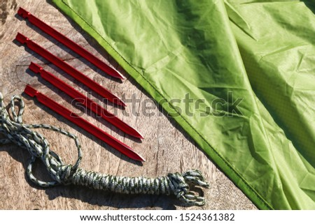 Camping equipment : Tent pegs or anchor and rope and Tarp. Gear for outdoor recreation. #1524361382