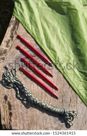 Camping equipment : Tent pegs or anchor and rope and Tarp. Gear for outdoor recreation. #1524361415