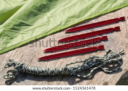Camping equipment : Tent pegs or anchor and rope and Tarp. Gear for outdoor recreation. #1524361478