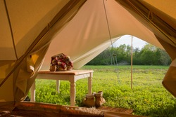 Camping in a cosy bell tent in the wilderness