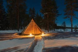 Camping in a Tipi in Lapland in snow at night