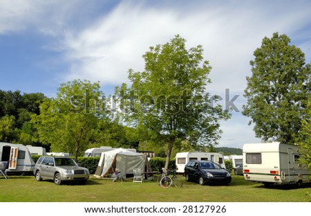 Camping in France with caravans between trees