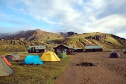 Camping in Landmannalaugar, Iceland.  This area is a popular tourist destination and hiking hub in Iceland's highlands.  It is known by its multicoloured mountains, lava fields and hot springs.