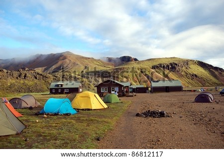 Camping in Landmannalaugar, Iceland.  This area is a popular tourist destination and hiking hub in Iceland\'s highlands.  It is known by its multicoloured mountains, lava fields and hot springs.