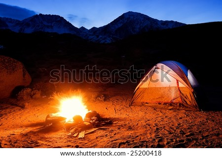 Camping In The Mountains, Camp Fire and Tent at Sunset
