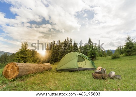 Camping in the mountains with the collected mushrooms and cooking facilities. #465195803
