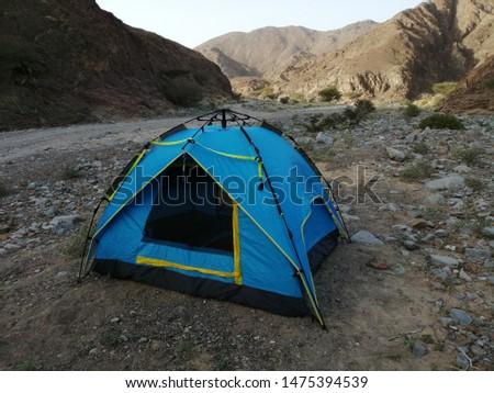 Camping in the rugged terrain of Wadi Showka, a dried riverbed, in Ras Al Khaimah emirate in the United Arab Emirates (UAE).