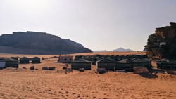 Camping in the Wadi Rum desert. Bedouin and tourist camp in the middle of the red desert in Jordan. Resting spot in the Arabian desert.