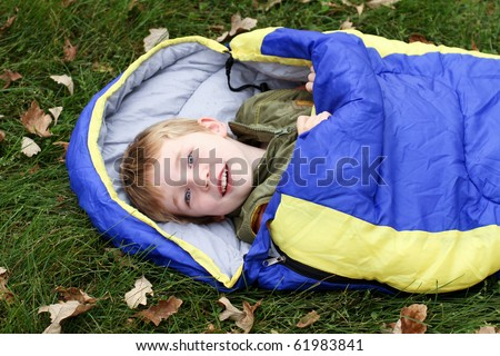 Camping kid in sleeping bag