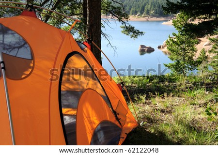 Camping Tent at Lake - stock photo