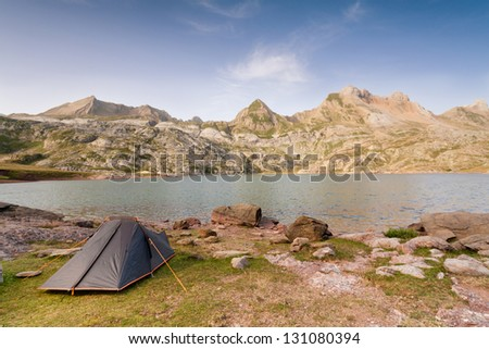 Camping Tent by Estanes Lake during sunrise. Spanish Pyrenees.